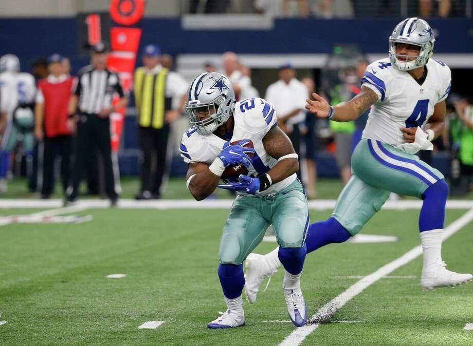 Dallas Cowboys quarterback Dak Prescott hands the ball off to running back Ezekiel Elliott as the Cowboys take on the New York Giants on Sept. 11, 2016, in Arlington. Photo: Michael Ainsworth /Associated Press / FR171389 AP