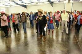 Residents enjoy a line dancing class at Kingwood Community Center.