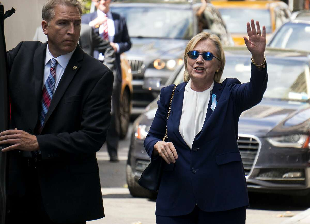 """Democratic presidential candidate Hillary Clinton walks from her daughter's apartment building Sunday, Sept. 11, 2016, in New York. Clinton unexpectedly left Sunday's 9/11 anniversary ceremony in New York after feeling """"overheated,"""" according to her campaign. (AP Photo/Craig Ruttle)"""