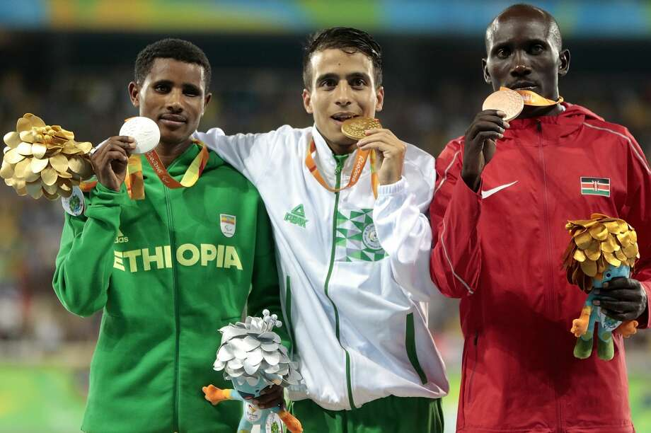 RIO DE JANEIRO, BRAZIL - SEPTEMBER 11: (L to R) Silver medalist Tamiru Demisse of Ethiopia , gold medalist Abdellatif Baka of Algeria and bronze medalist Henry Kirwa of Kenya celebrate on the podium at the medal ceremony for the Men's 1500m - T13 Final during day 4 of the Rio 2016 Paralympic Games at the Olympic Stadium on September 11, 2016 in Rio de Janeiro, Brazil. (Photo by Alexandre Loureiro/Getty Images) Photo: Alexandre Loureiro/Getty Images