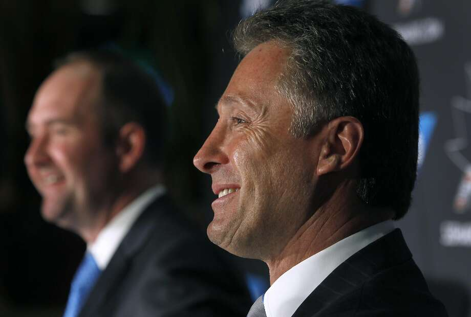 Team general manager Doug Wilson smiles after introducing Peter DeBoer (left) as the new head coach of the San Jose Sharks during a news conference at the SAP Areana in San Jose, Calif. on Thursday, May 28, 2015. Photo: Paul Chinn, The Chronicle