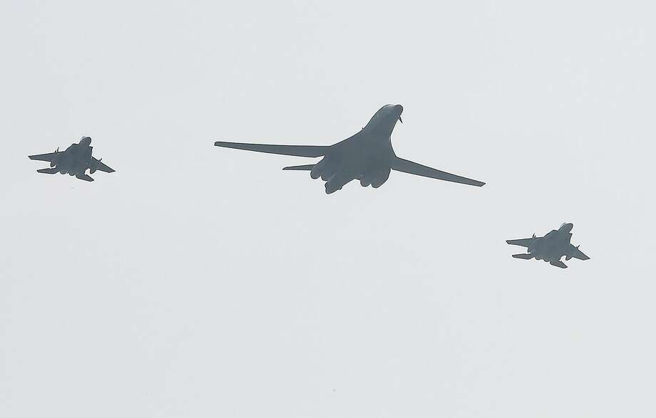 A U.S. B-1B bomber is escorted by South Korean fighter jets in a flyover near the border with the North. Photo: Yonhap News/Newscom, TNS