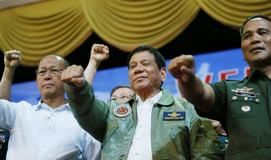 President Rodrigo Duterte (center) said he wants U.S. forces to leave the country's south. Photo: Bullit Marquez, Associated Press