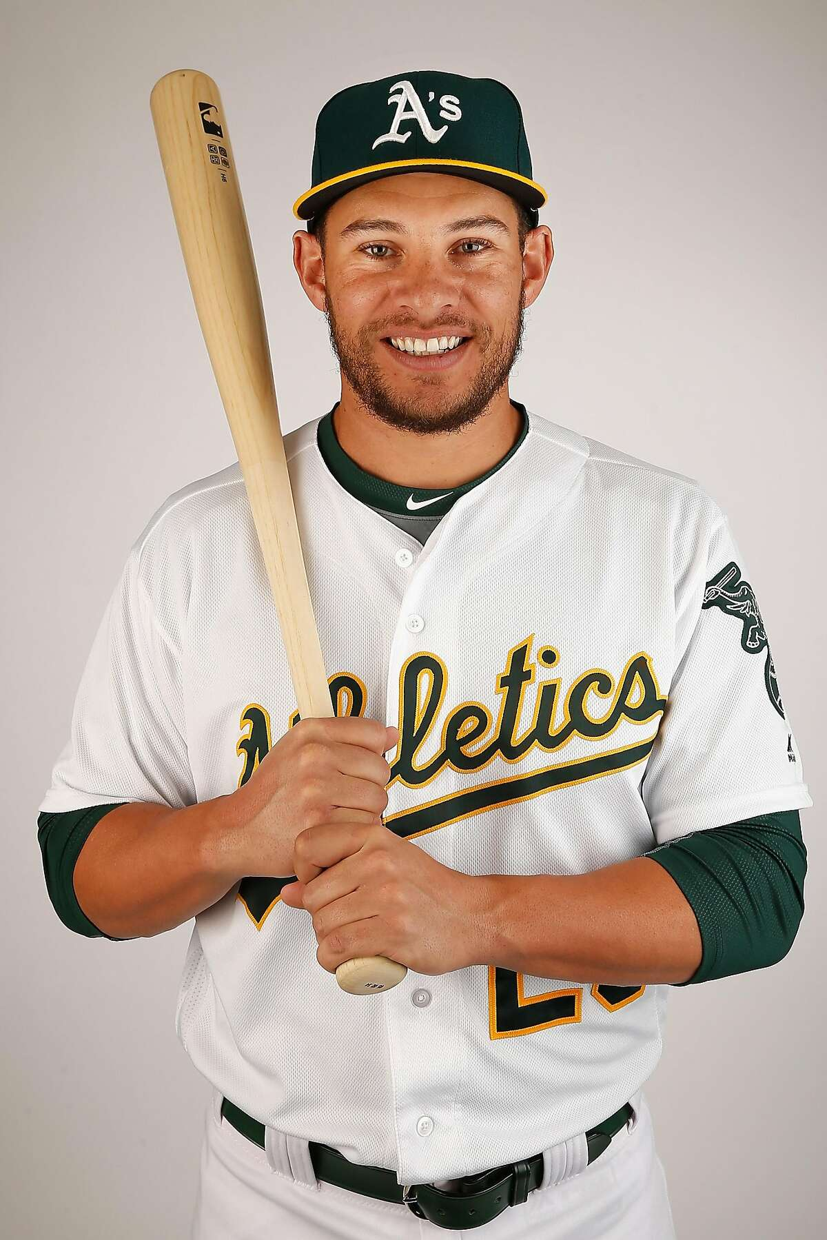 MESA, AZ - FEBRUARY 29: Danny Valencia #26 of the Oakland Athletics poses for a portrait during the spring training photo day at HoHoKam Stadium on February 29, 2016 in Mesa, Arizona. (Photo by Christian Petersen/Getty Images)