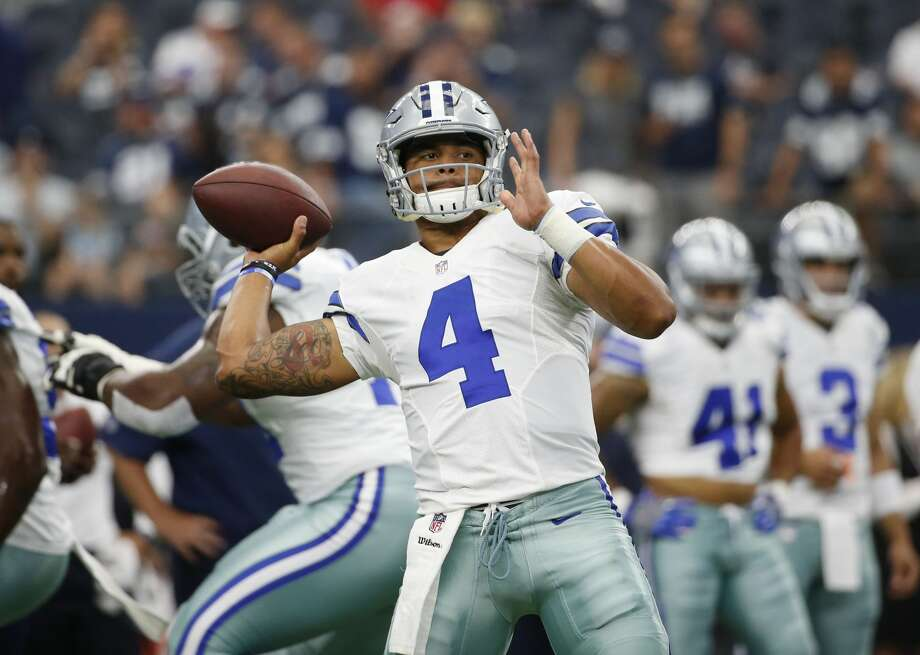 Dallas Cowboys quarterback Dak Prescott (4) throws prior to an NFL football game against the New York Giants on Sunday, Sept. 11, 2016, in Arlington, Texas. (AP Photo/Michael Ainsworth) Photo: Michael Ainsworth/Associated Press