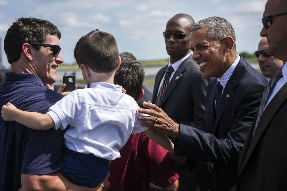 President Barack Obama greets well-wishers at the Philadelphia International Airport, en route to a Hillary for America campaign event in Philadelphia, Sept. 13, 2016. The president also was to participate in a Democratic National Committee roundtable before traveling to New York later on Tuesday. (Al Drago/The New York Times) Photo: AL DRAGO, NYT