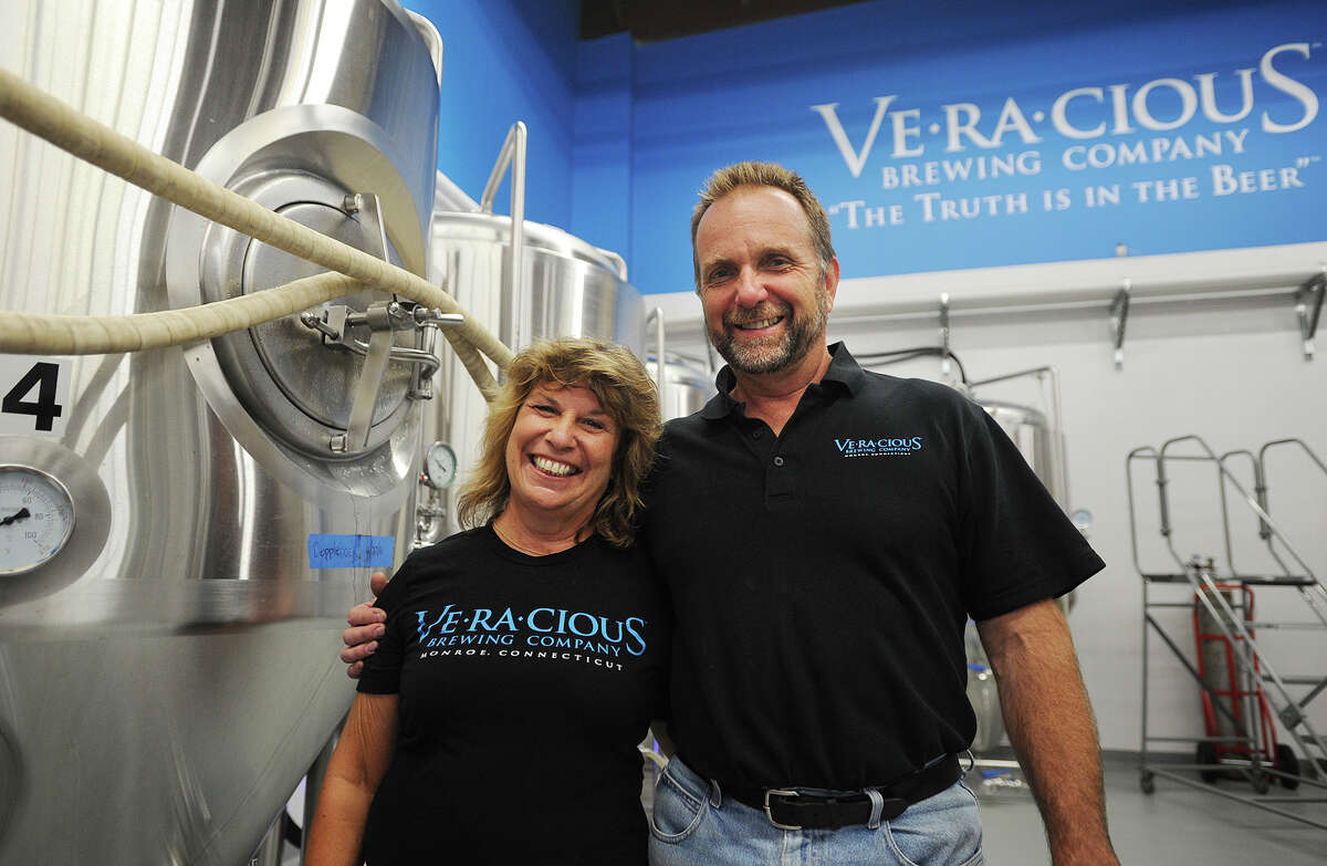 Tess and Mark Szamatulski opened their Veracious Brewing Company brewery one year ago at 246 Main Street in Monroe, Conn. next to their Maltose Express brewing supplies store.