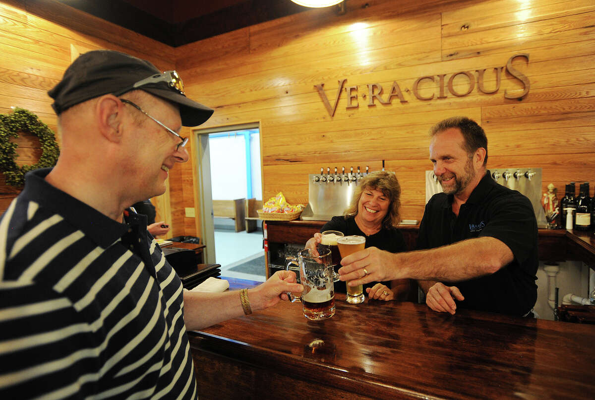 Tess and Mark Szamatulski, right, have a beer with a customer at their Veracious Brewing Company at 246 Main Street in Monroe, Conn. on Thursday, September 8, 2016.