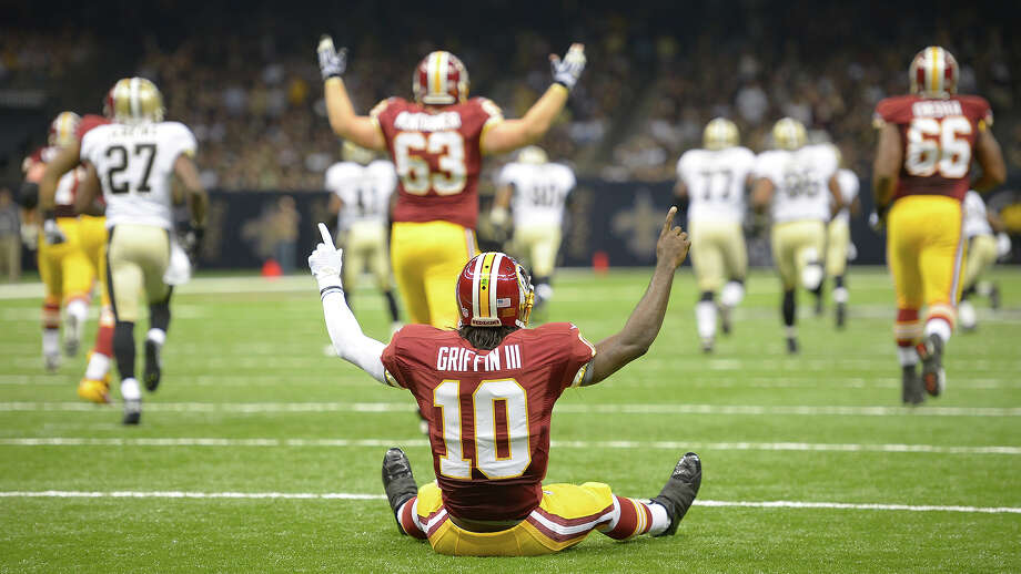 NEW ORLEANS LA  SEPTEMBER 9:  Redskins quarterback Robert Griffin III (10) celebrates his first NFL touchdown after he got knocked down on a short pass play to  wide receiver Pierre Garcon (88), who went 89 yard for a 1st quarter touchdown as the Washington Redskins defeat the New Orleans Saints 40 - 32  at the Mercedes-Benz Superdome in New Orleans LA September 9, 2012 (Photo by John McDonnell/The Washington Post via Getty Images) Photo: The Washington Post/The Washington Post/Getty Images