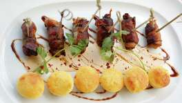 Bacon-wrapped quail with buttermilk sauce, molasses and tiny cornbread muffins at Cafe Annie, Tuesday, July 19, 2016, in Houston.