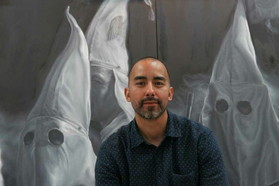 "Vincent Valdez spent the past year working on ""The City"" for an exhibit at David Shelton Gallery in Houston. Photo: Photos By Billy Calzada /San Antonio Express-News / San Antonio Express-News"