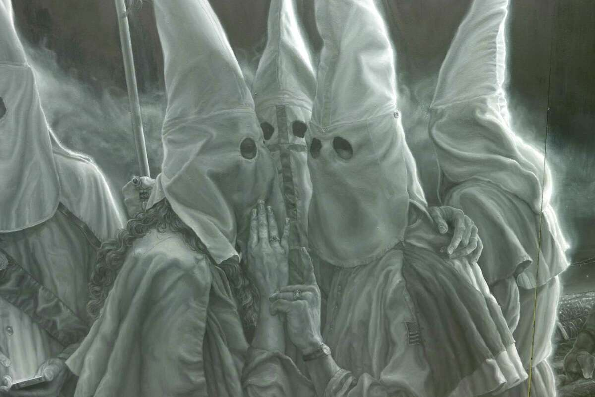 Vincent Valdez has spent a year working on a monumental painting for an exhibit at the David Shelton Gallery in Houston. This is a detail from the piece that depicts a KKK gathering and was featured in the New York Times in March 2016. The artist described the haunting image as a