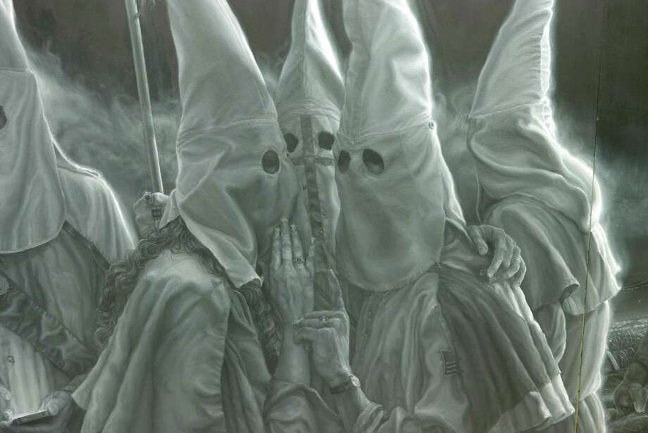 """Vincent Valdez has spent a year working on a monumental painting for an exhibit at the David Shelton Gallery in Houston. This is a detail from the piece that depicts a KKK gathering and was featured in the New York Times in March 2016. The artist described the haunting image as a """"selfie for 21st-century America."""" Photo: Billy Calzada /San Antonio Express-News / San Antonio Express-News"""