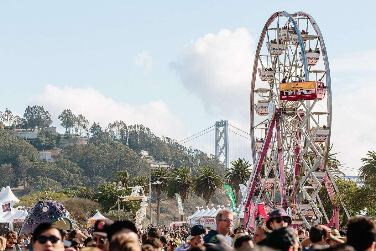 The ferris wheel and Bay Bridge at Treasure Island Music Festival in San Francisco, Calif., Saturday, October 17, 2015.