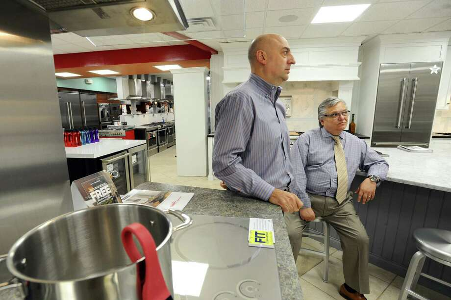 County TV & Appliance president Vincent Vetrini, right, and manager Phil De Terlizzi discuss the appliances they stock in Stamford, Conn. on Monday, September 12, 2016. Photo: Michael Cummo / Hearst Connecticut Media / Stamford Advocate