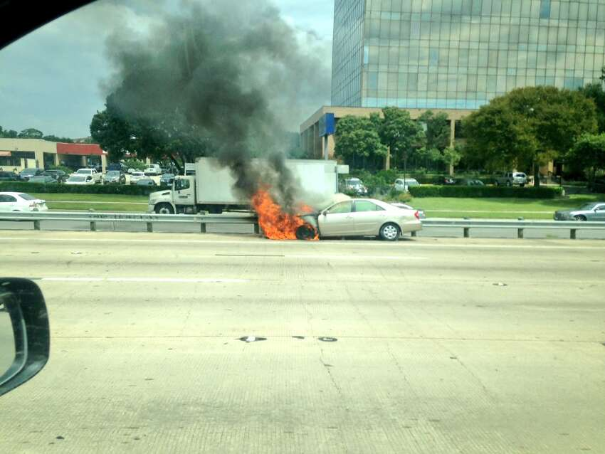 San Antonio emergency crews respond to a call for a car on fire on I-10 near the Loop 410 interchange on Tuesday, September 13, 2016.
