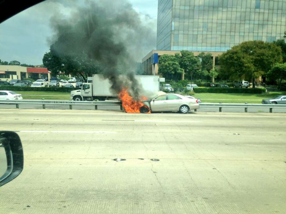 "San Antonio emergency crews respond to a call for a car on fire on I-10 near the Loop 410 interchange on Tuesday, September 13, 2016. ""@mysa currently happening at I-10W before Callaghan"" Photo: Joshua J. Tijerina"