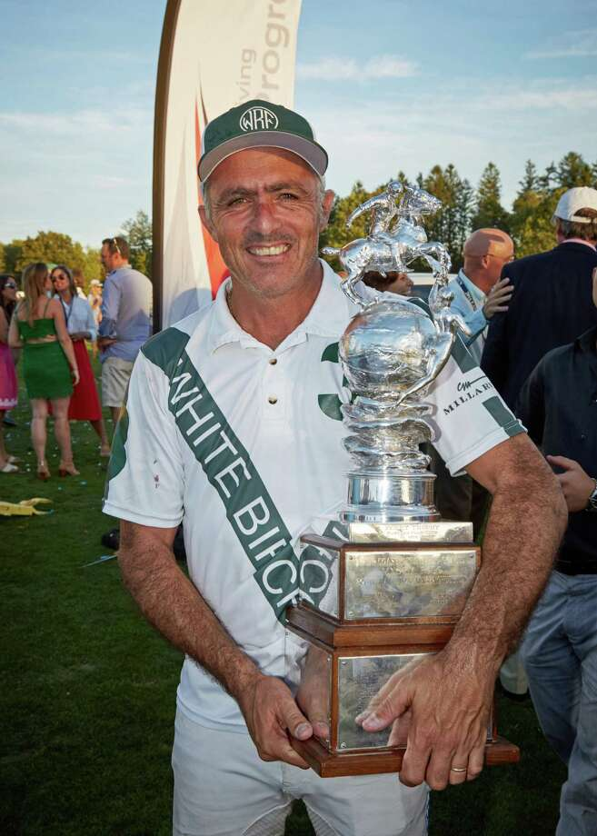 White Birch's Mariano Aguerre held the Perry Trophy after winning the 2016 East Coast Open in Greenwich. Photo: Contributed