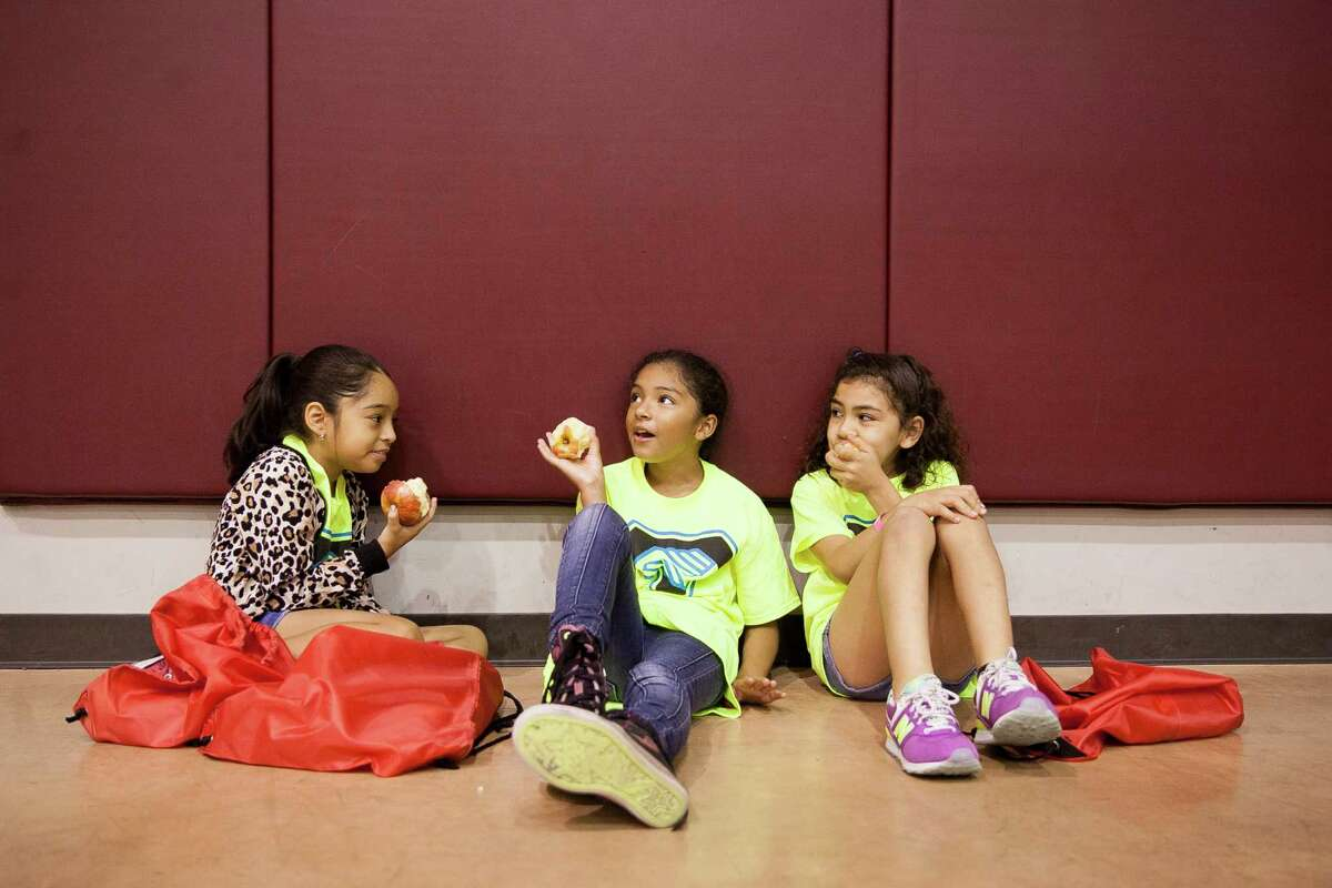 This 2015 file photo shows students snacking on apples at the George Gervin Academy, a charter school. It appears the NAACP is painting all charter schools with an unfair broad brush.