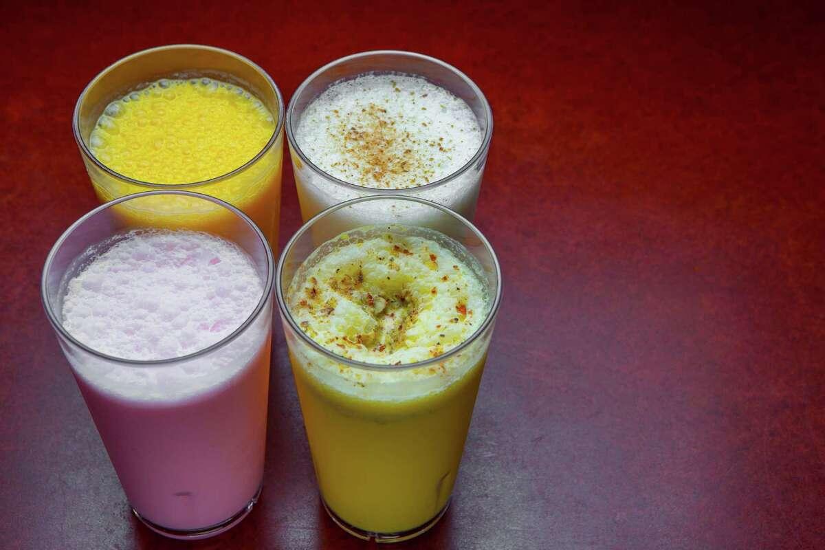 From top left: mango shake, salt lassi, rose milk and badam milk at Shri Balaji Bhavan