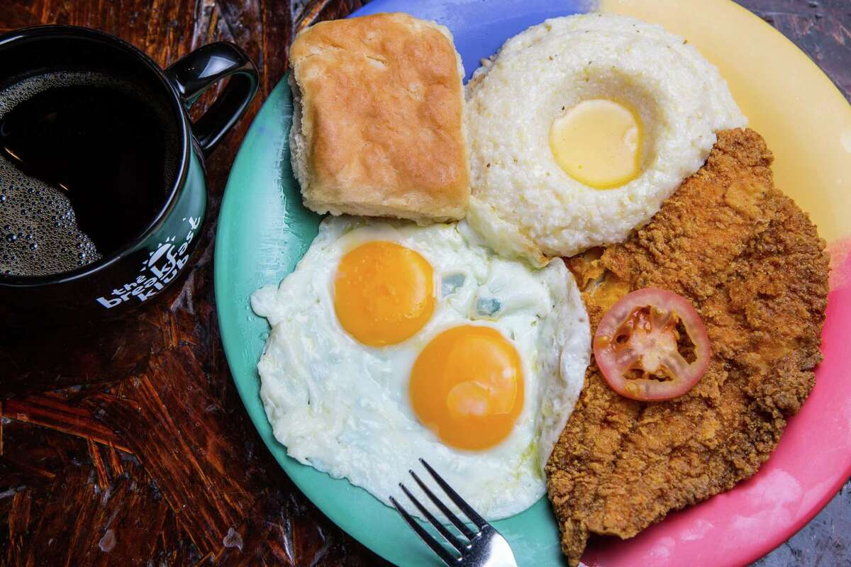 Catfish and grits with sunny side up eggs and biskit atThe Breakfast Klub