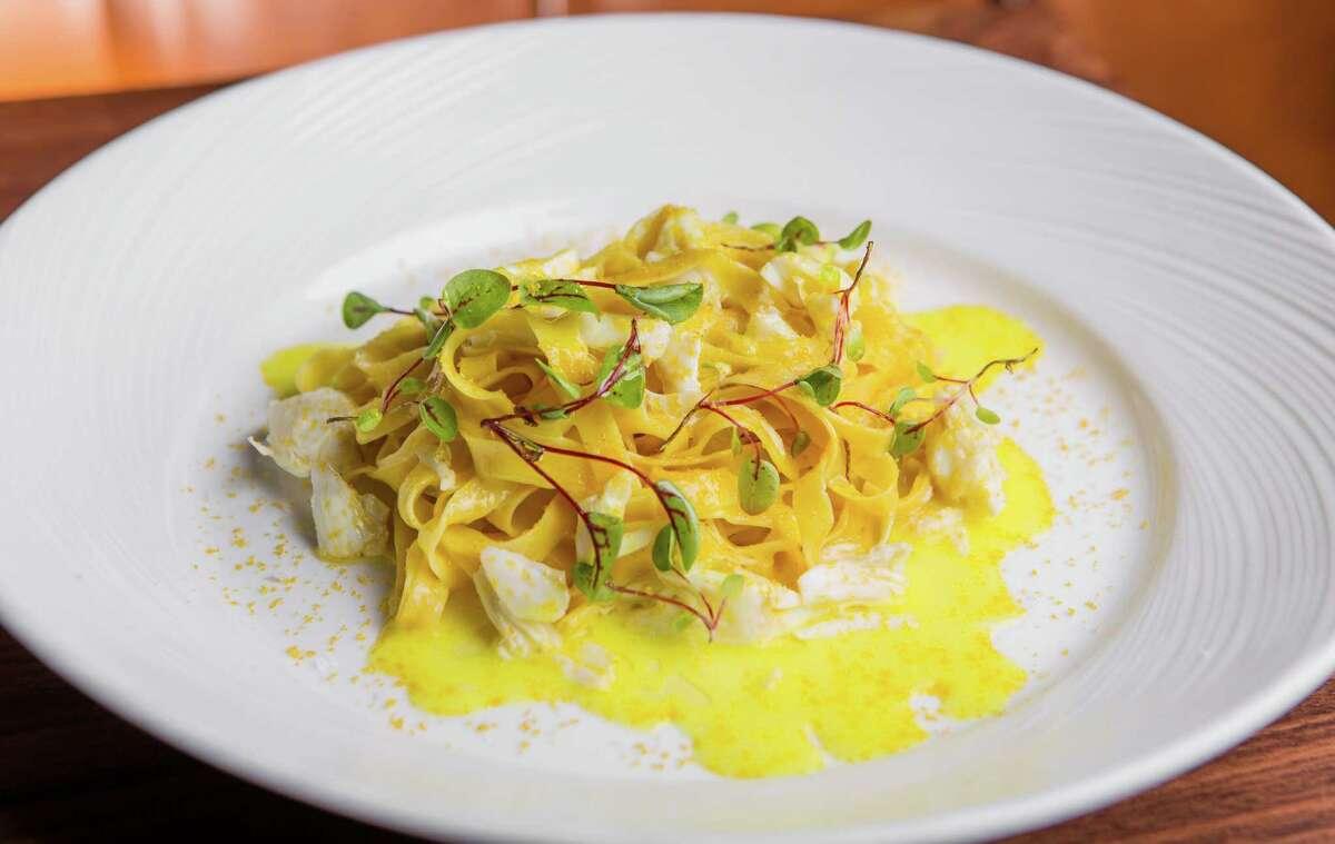 SaltAir's saffron fettuccine handmade pasta with crabmeat, lemon butter, and bottarga.