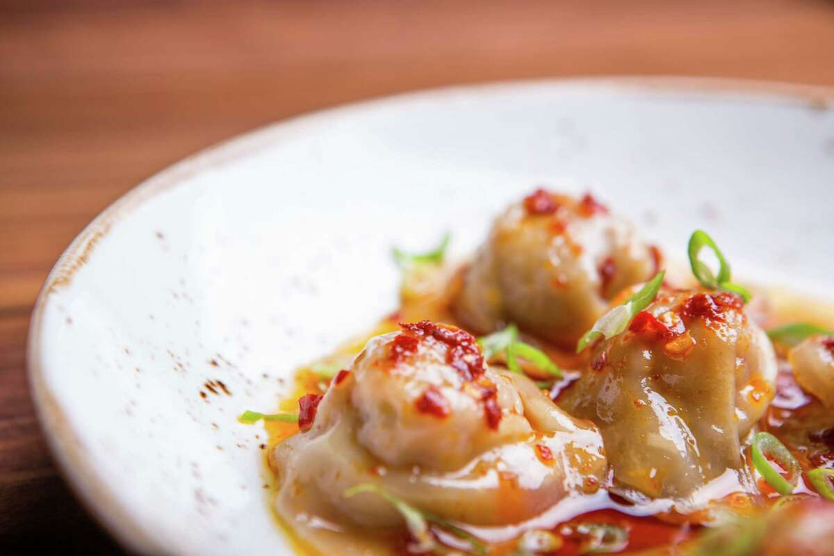 Dumplings with pork and green onion filling and red chili oil at SaltAir