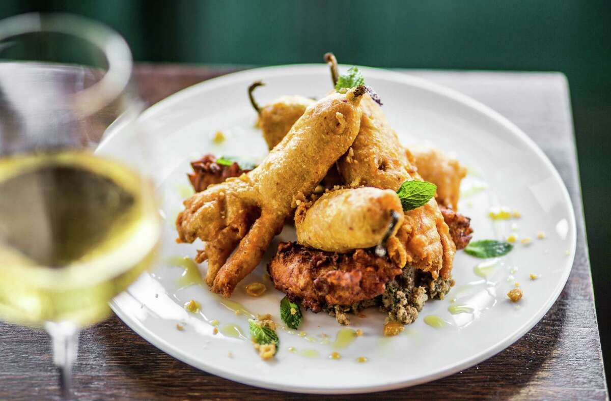 Squash blossoms with zucchini fritters, walnut garlic pesto, mint and chickpea at Helen