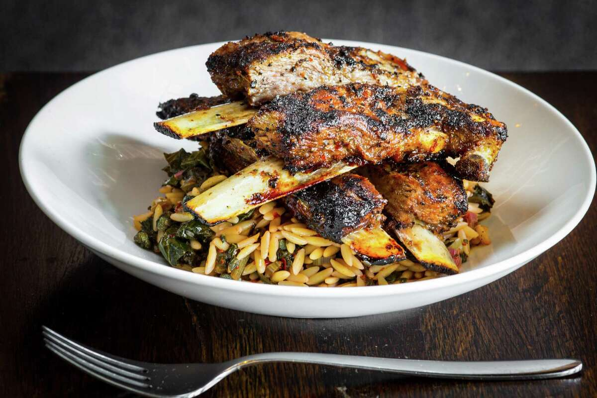 Lamb ribs with brassed greens and orzo pasta at Helen