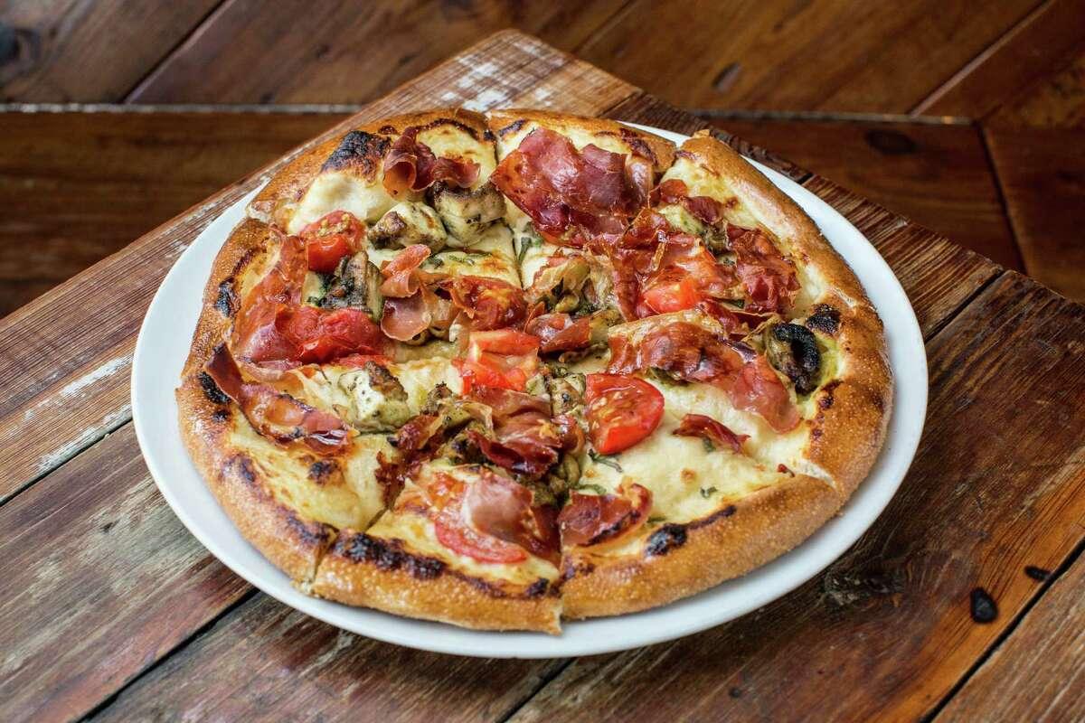 Chicken pizza with prosciutto, fresh tomato, sage and saba at Coltivare