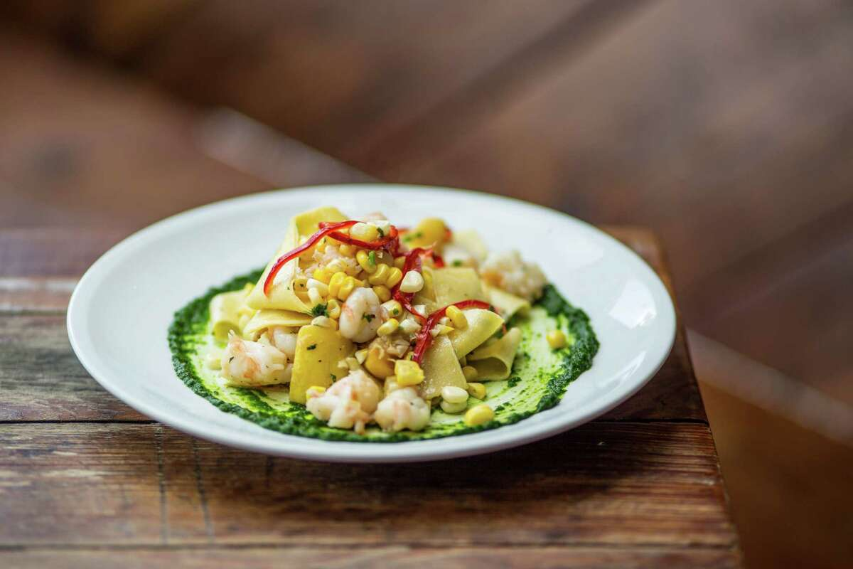 Tagliatelle with Gulf shrimp, summer vegetables, chilis and herbs at Coltivare