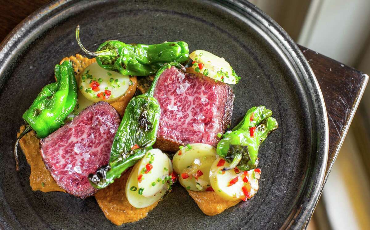 Marble Ranch Wagyu Denver cut steak with charred squash romesco, confit potatoes and padron peppers at Pax Americana