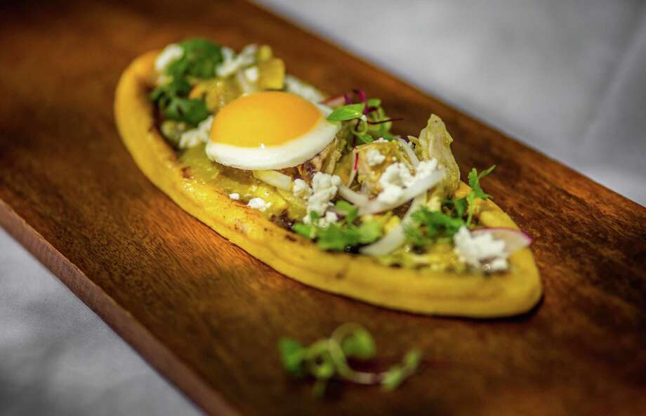 Huarache con Huevos (large sandal-shaped masa cake topped with refried beans, queso fresco, salsa de ajo and chicken served with two eggs sunny-side-up) at Hugo's Photo: Nick De La Torre, Houston Chronicle / © de la Torre Photos LLC