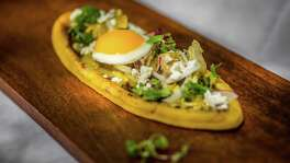 ** Top 100 Restaurants ** Hugo's Restaurant's Huarache con Huevos, large sandal-shaped masa cake topped with refried beans, queso fresco, salsa de ajo and chicken served with two eggs sunny-side-up. Photographed Thursday, June 30, 2016, in Houston. ( Nick de la Torre /  )