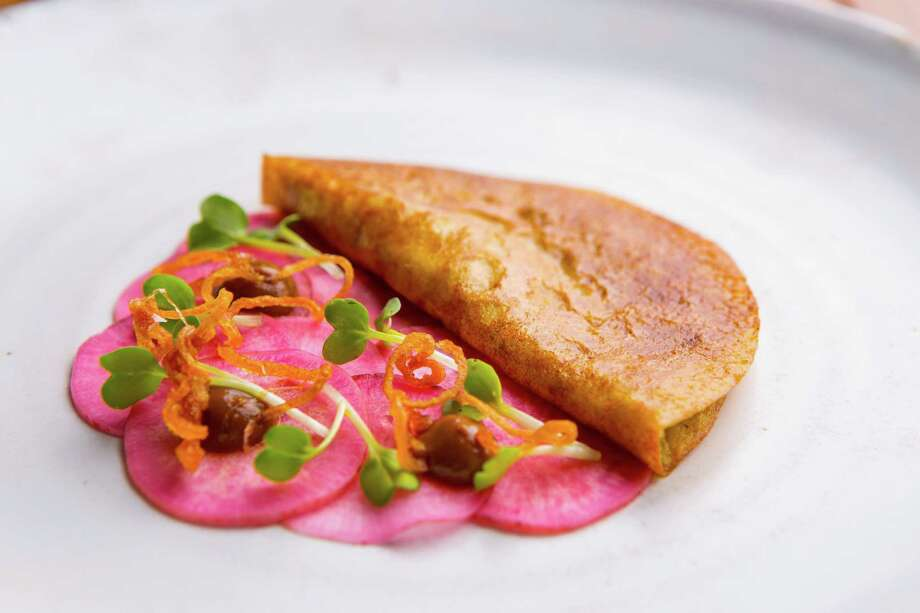 Mung bean pancake stuffed with alliums, potato and miso, with pickled beets and burnt onion at Oxheart Photo: Nick De La Torre, Houston Chronicle / © de la Torre Photos LLC