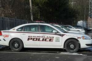 A fleet of Guilderland police patrol cars are parked next to the police station at Guilderland Town Hall on Friday, March 14, 2014, in Guilderland, N.Y. Guilderland Police officers are the highest paid police force in the Capital Region followed by Bethlehem and Schenectady, according to a new report from the Empire Center, a nonprofit research center based in Albany. (Lori Van Buren / Times Union archive)