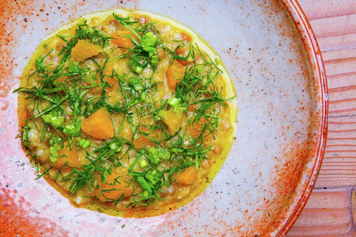 Porridge of grains and Texas winter wheat cooked in vadouvan spices, with cauliflower, cilantro and 'Navel' oranges at Oxheart