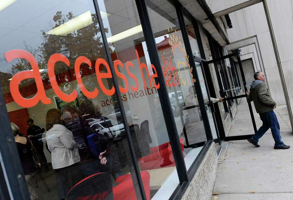 A man leaves Access Health CT, Connecticut's health insurance exchange insurance store, in New Britain. Local insurance company ConnectiCare just announced that it could pull out of the exchange, leaving it without its largest insurer.
