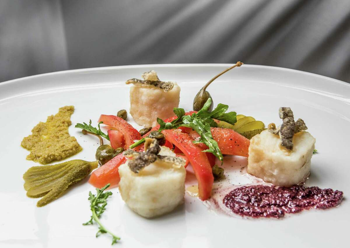 Bacalao (Spanish cod, tomatoes, olive tapenade, cornichons, capers and cod chicharrones) at BCN