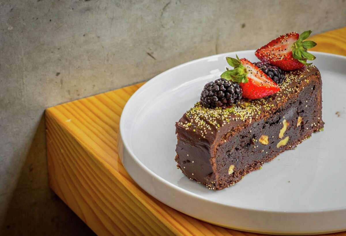 Cafe Annie Brownie with chocolate ganache, fresh berries and poppy seeds at Pondicheri