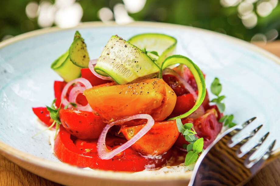 Covey Rise heirloom tomatoes with cucumber ribbons, cane vinegar, basil and Duke's at Bernadine's Photo: Nick De La Torre, Houston Chronicle / © de la Torre Photos, LLC