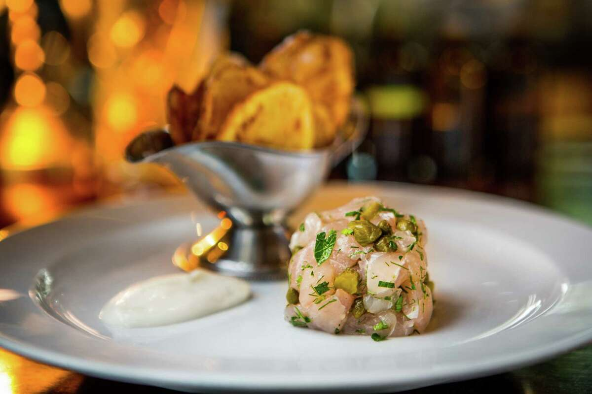 Hunky Dory's snapper tartare with Gulf fish, capers, cornchons, dill, shallots, served with chips and malt vinegar aioli.