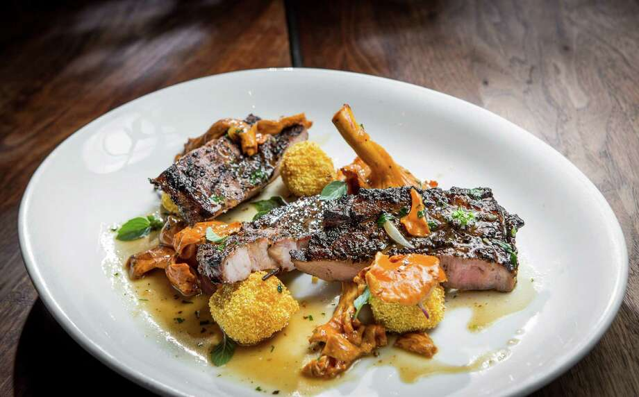 Grilled pork collar with fried green tomatoes and chanterelle gravy at Underbelly Photo: Nick De La Torre, Houston Chronicle / © de la Torre Photos LLC