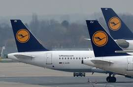 FILE - In this Dec. 1, 2014 file photo Lufthansa planes are parked at the airport in Duesseldorf, Germany. German airline Lufthansa will report earnings for the first half of the year Tuesday, Aug. 2, 2016. (AP Photo/Martin Meissner, File)
