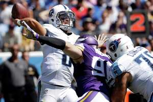 Tennessee Titans quarterback Marcus Mariota (8) passes as he is pressured by Minnesota Vikings defensive end Brian Robison (96) in the first half of an NFL football game Sunday, Sept. 11, 2016, in Nashville, Tenn. (AP Photo/James Kenney)