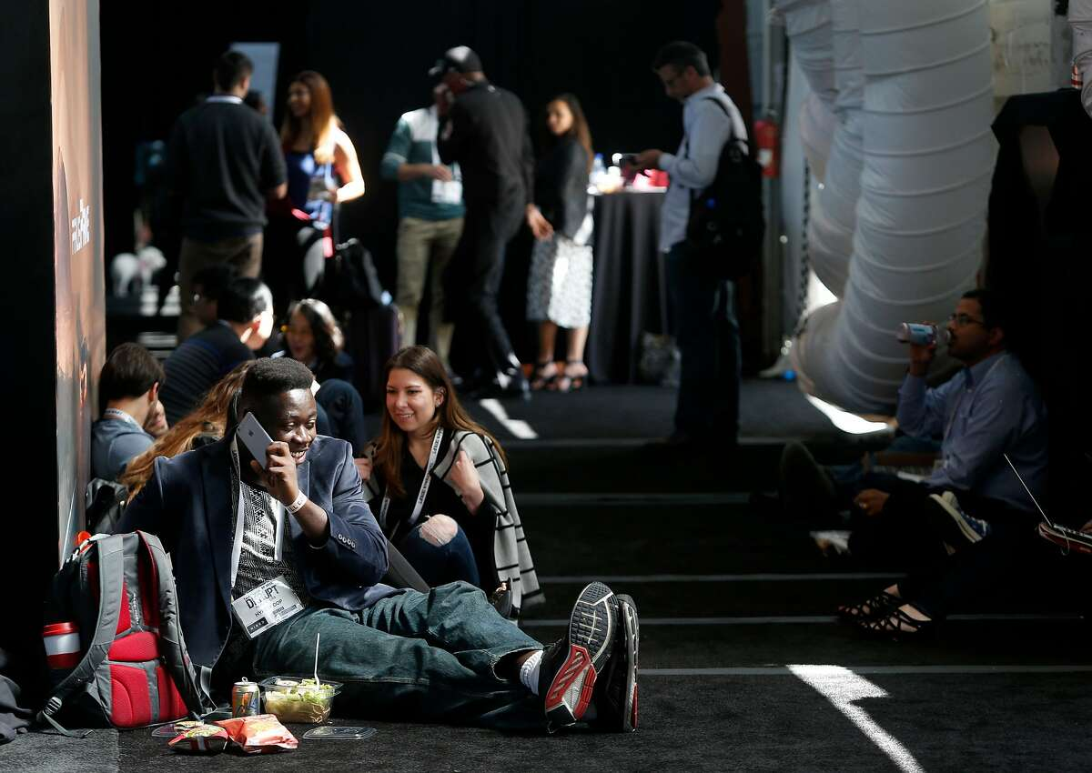 Attendees sit in the aisles during the lunch break at the TechCrunch Disrupt conference in San Francisco, Calif. on Tuesday, Sept. 13, 2016.