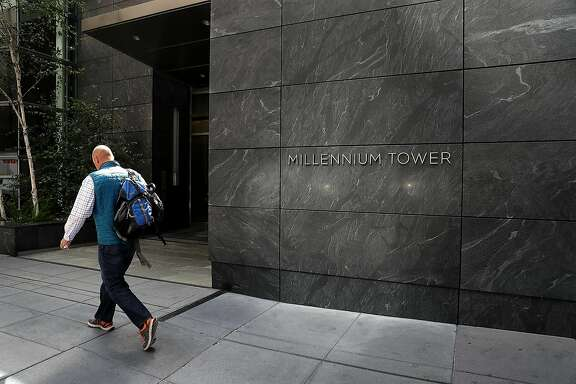 SAN FRANCISCO, CA - AUGUST 11:  A person walks by the Millennium Tower on August 11, 2016 in San Francisco, California. A $500 million lawsuit has been filed against building owner the owner of the Millennium Tower, Millennium Partners, and the Transbay Joint Powers Authority after it was revealed that the building had sunk 16 inches into the ground and is leaning two inches to the northwest. The 58-story, 419-residence building was completed in 2009.  (Photo by Justin Sullivan/Getty Images)