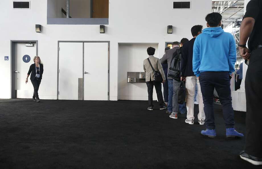 Men attending the TechCrunch Disrupt conference stand in a long line to use the restroom while there's no waiting for the women's room (left) in San Francisco, Calif. on Tuesday, Sept. 13, 2016. Photo: Paul Chinn, The Chronicle