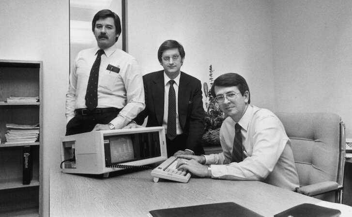 Compaq Computer Co-founders (L-R: Jim Harris, Bill Murto, Rod Canion) with the first Compaq portable computer.  Credit: Courtesy of FilmRise
