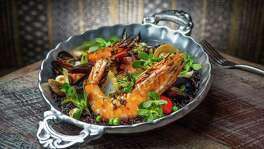 *** Top 100 Restaurants *** Caracol's mariscos con arroz negro, shrimp, clams, mussels, squid, octopus, chorizo, with rice cooked in black bean broth. Photographed Wednesday, June 29, 2016, in Houston. ( Nick de la Torre /  )